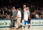 carmelo anthony injures knee